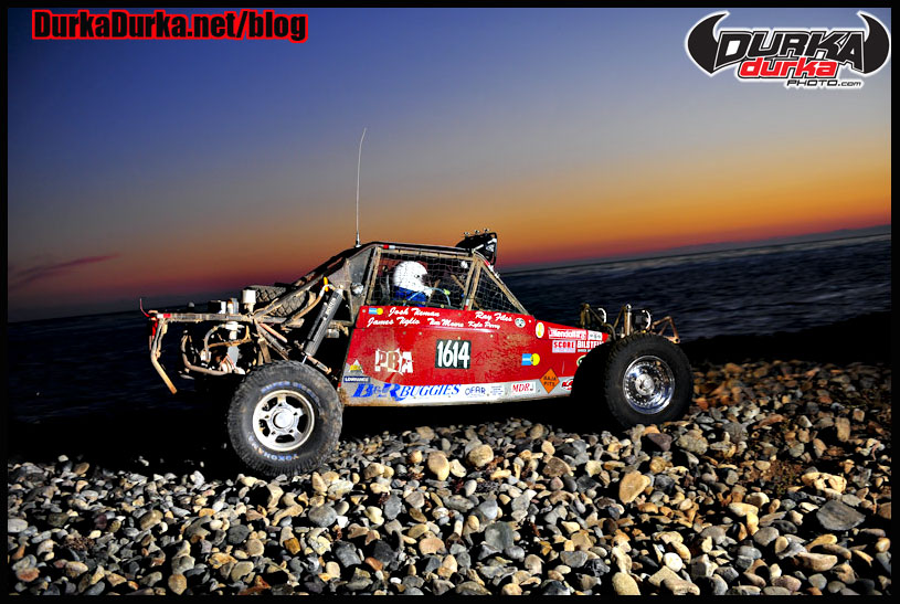 Ray Files negotiates the rock whoops at Erindira in his 1-2/1600 car as the sun sets on the Pacific Ocean.