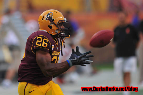 ASU RB Cameron Marshall catches a pass during warmups.