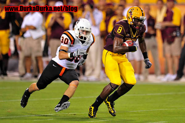 ASU WR Gerell Robinson is chased by ISU LB AJ Storms.