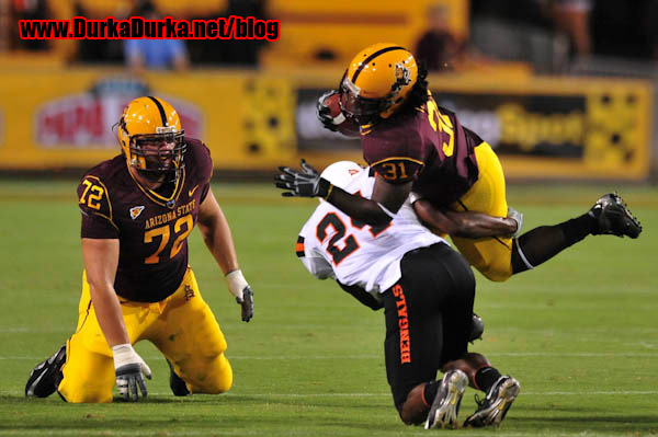 ASU RB Dimitri Nance is tackled by ISU DB Phillip Pleasant