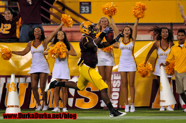 ASU RB Ryan Bass celebrates as he scores a touchdown.