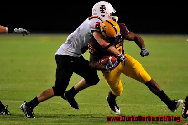ASU RB Jarrell Woods is tackled by ISU DB Keith McGowen.