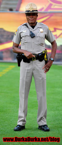 An Arizona DPS officer looks on prior to the start of the game.