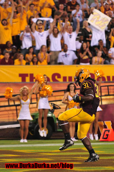 ASU RC Dimitri Nance celebrates after scoring a touchdown.