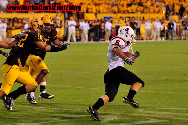 ISU RB Clint Knickrehm is chased by ASU DE Jamaar Jarrett.