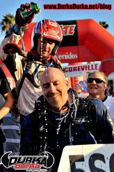 A hack and his Monkey celebrate at the finish after more than 31 hours of racing.