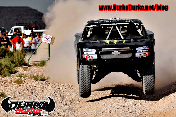 Robby Gordon jumps the road crossing.