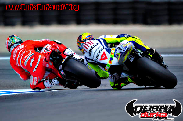 Nicky Hayden is chased by Valtino Rossi into turn 11.