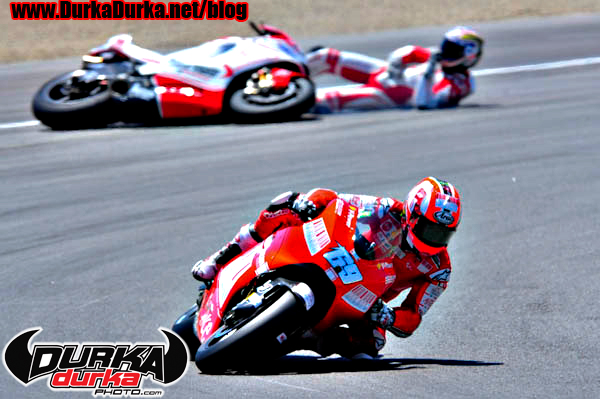 Hayden races through turn 2 while Canepa crashes.