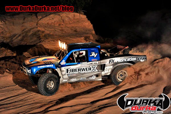 Jason McNeil races through a canyon at the DRIVE Still of the Night 200.