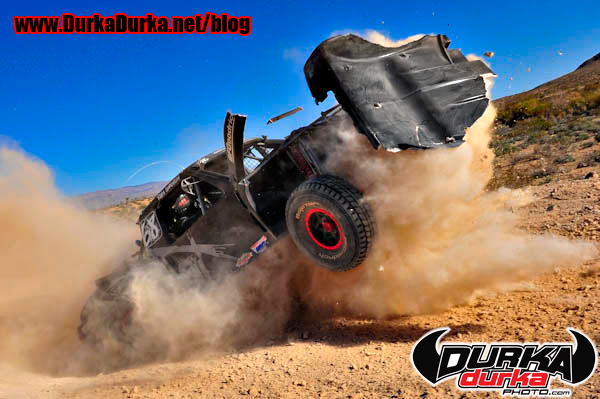 Marc Ewing hits a secret button ejecting his hood during the Mint 400.