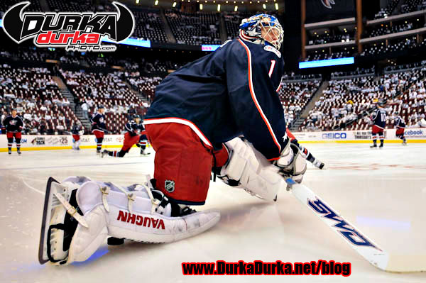 Bluejackets Goaltender Steve Mason stretch before the game.