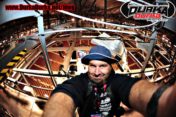Me, high above the ice in the catwalks after the game.  Remote over my right shoulder.