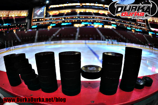 Pucks are stacked to spell NHL