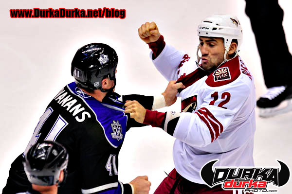 Phoenix Coyotes left wing Paul Bissonnette (12) and Los Angeles Kings left wing Raitis Ivanans (41) fight during the first period.