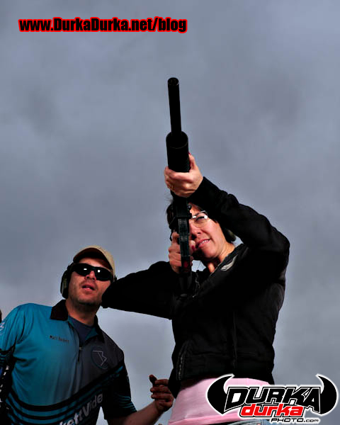 Matt coaches Stephanie on the rimfire AR.